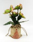 Flores artificiales de Navidad en el bolso del lino para la decoración del día de fiesta