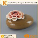 Bottiglia di profumo di ceramica del vaso di pietra dell'aroma con la protezione del fiore
