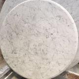 シンプルな設計の大理石のダイニングテーブルの円形の大理石の平板のテーブルの上