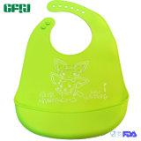 緑の漫画キャッチャーが付いている防水FDA/LFGBの承認の赤ん坊の摩耗のシリコーンの幼児の胸当て