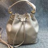 Tipo de couro bolsa Emg4569 do cilindro do saco de ombro da menina da forma do laço