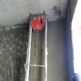 構築の使用の自動壁のレンダリング機械