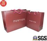 Bolsas de papel con las manetas/la bolsa de papel al por mayor con la insignia impresa
