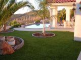 Parcheggio modific il terrenoare il tappeto erboso artificiale dell'erba