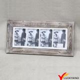 型の灰色のマルチ入り口のぼろぼろのシックな壁の写真フレーム