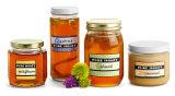 Le choc en verre à extrémité élevé pour le miel, encombrement, nourriture, marinent les bouteilles en verre