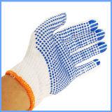 Un côté a tricoté les gants fonctionnants de coton pointillés par PVC