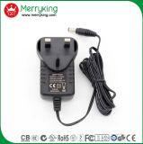 La marca di Merryking Parete-Monta l'adattatore BRITANNICO di potere della spina AC/DC dell'adattatore di 12V 1A