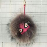 Il mostro Premium all'ingrosso poco costoso della sfera della pelliccia del Raccoon di qualità fa la pelliccia POM Keychain dei giocattoli della pelliccia