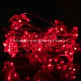 A corda vermelha do fio de cobre do diodo emissor de luz dos bordos ilumina a luz feericamente da corda para a decoração Home