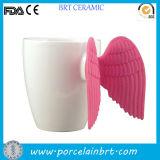 Taza blanca de cerámica en blanco de encargo del ala del ángel
