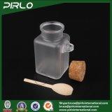 100ml 3.3ozの木のスプーンのコルクが付いている無光沢の表面のプラスチックバスソルトのびんが付いている正方形の形のプラスチックコルクのびんの装飾的な瓶