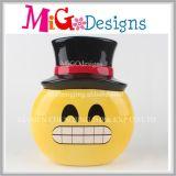 大変な微笑のEmojiの陶磁器の銭箱か貯金箱