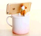 A caneca de café cerâmica do chá da venda quente com tampa tem o suporte do telefone móvel