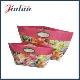 Подгоняйте овальными сумки подарка покупкы бумаги искусствоа ручки напечатанные цветками