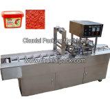 唐辛子ソースコップの詰物およびシーリング機械
