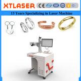Incisione e taglio dei monili della targhetta del laser di Xt per le catene chiave di gocce della collana degli anelli di cerimonia nuziale dei braccialetti dei braccialetti