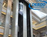 Elevatore facente un giro turistico di osservazione della baracca di vetro