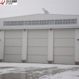De Sectionele Gemotoriseerde Industriële Thermische Geïsoleerdel Verticale Schuifdeur van uitstekende kwaliteit