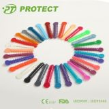 Proteger el lazo colorido elástico dental ortodóntico de la ligadura con CE