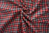 Un tessuto delle tre lane di colori per colore rosso del vestito