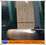 La configuration en bois a enduit les bobines d'une première couche de peinture en acier