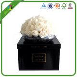 Упаковывать черноты нестандартной конструкции бумажный вокруг коробки цветка с тесемкой