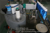 Uma máquina de etiquetas lateral do frasco da etiqueta para o frasco do suco