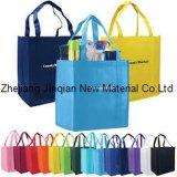 Tissu 100% non-tissé personnalisé de polypropylène coloré de logo pour le sac à provisions