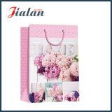 卸し売り花デザイン4cによって印刷される買物をするキャリアのギフトの紙袋