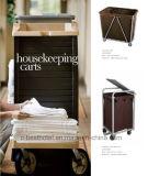 As tarefas domésticas do quarto de hotel Carts o carro de linho do serviço do trole
