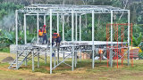 セメントのボードのフロアーリングが付いている現実的なプレハブの鉄骨構造グループの家