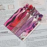 Lazo elástico del pelo con el parte movible de la tarjeta