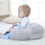 Il colore grigio ha farcito il cuscino infantile di sostegno della parte posteriore del bambino