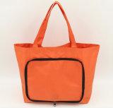 Bevordering die Oranje het Winkelen Handtassen vouwen