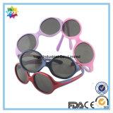 Passar a En/an/as óculos de sol polarizados do desenhador da forma tipo redondo para miúdos
