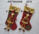 Los pun¢os peludos cuelgan el regalo Legged de la Navidad de la media del reno