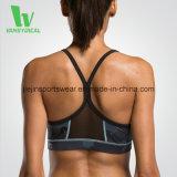 Lo sport sexy caldo di prezzi competitivi della fabbrica mette in mostra il reggiseno con la maglia del triangolo sulla parte posteriore