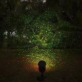 Decoração vermelha e verde do projetor estrelado ao ar livre dos lasers piscar de Natal da luz