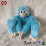 Jouet bourré par singe fait sur commande se reposant bleu-clair de peluche de la CE