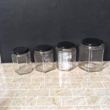 Tarro de cristal hexagonal del alimento de la categoría alimenticia 30ml 100ml 200ml 300ml 500ml para el atasco de la miel con la tapa del estaño