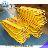 Esticador plástico amarelo da colher