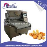 Bolinhos automáticos e bolo de Multidrop que dão forma à máquina para produzir o biscoito