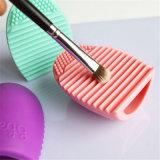 El maquillaje de los cosméticos de las herramientas de la limpieza de cepillo del maquillaje del silicón que se lava aplica a tarjeta del depurador con brocha que lava la herramienta cosmética del producto de limpieza de discos de cepillo