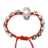 Braccialetto registrabile del cranio placcato argento nero dell'oggetto d'antiquariato del Knit della corda rossa