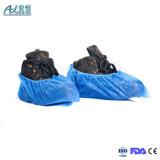 青く使い捨て可能なプラスチック防水靴カバーを買いなさい