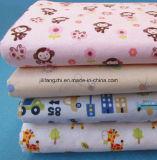 綿または印刷されるか、またはとかされるまたは寝具かブラシをかけられたかフランネルファブリック