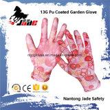 l'unité centrale 13G a enduit le gant de travail de jardin
