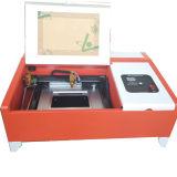 Appareil de bureau 3020 de machine de gravure de laser pour le bouton avec le Tableau de nid d'abeilles