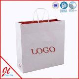 Bolsas de papel promocionales de las compras elegantes grandes con insignia y la impresión
